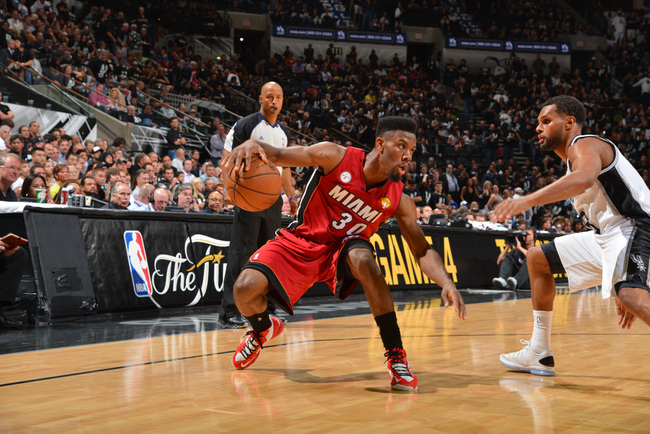 Hi-res-170355435-norris-cole-of-the-miami-heat-drives-against-patty_crop_650