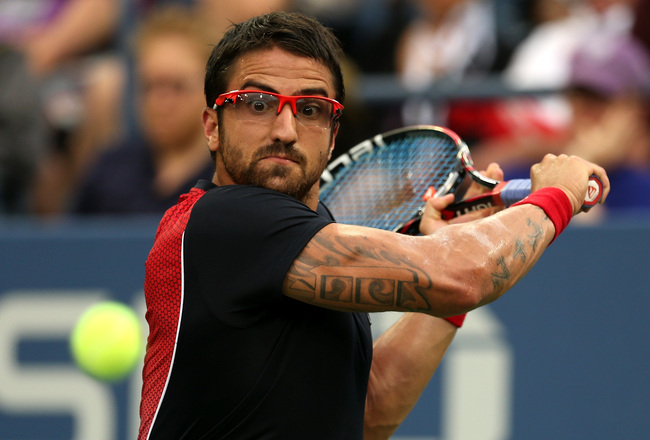 Hi-res-179384345-janko-tipsarevic-of-serbia-plays-a-backhand-to-david_crop_650