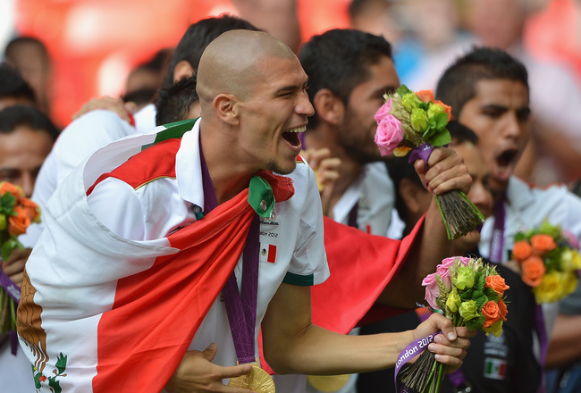 Hi-res-150157349-jorge-enriquez-of-mexico-celebrates-winning-the-gold_crop_650x440
