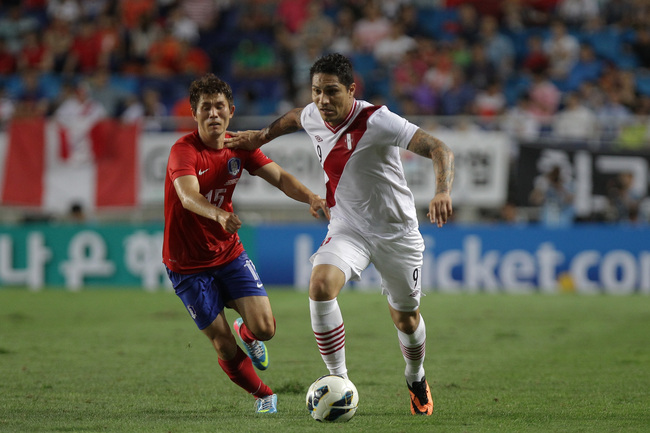 Hi-res-176500645-paolo-guerrero-of-peru-compete-for-the-ball-with-cho_crop_650
