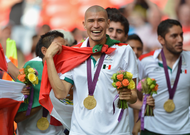 Hi-res-150157324-jorge-enriquez-of-mexico-celebrates-winning-the-gold_crop_650