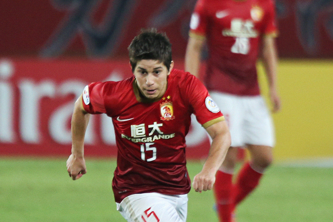Hi-res-182651420-dario-conca-of-guangzhou-evergrande-in-action-during_crop_650