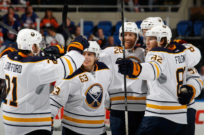 Hi-res-184718856-the-buffalo-sabres-celebrate-a-game-tying-goal-at-17-59_crop_650