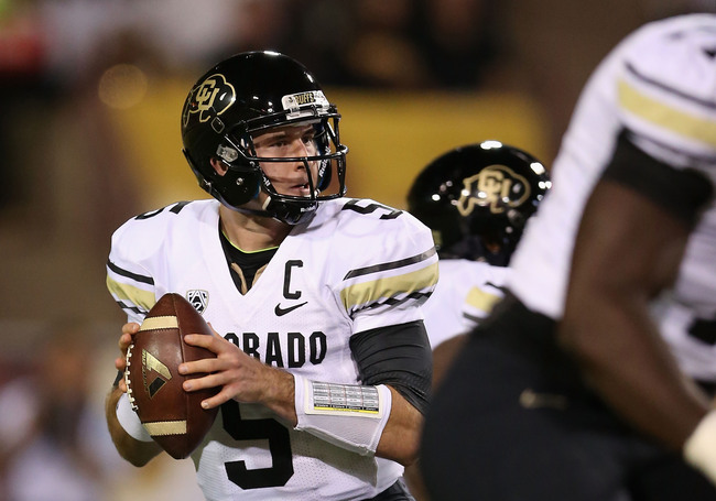 Hi-res-184685571-quarterback-connor-wood-of-the-colorado-buffaloes-drops_crop_650