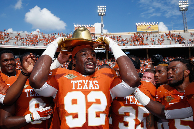 Hi-res-184228123-reggie-wilson-of-the-texas-longhorns-celebrates-with_crop_650