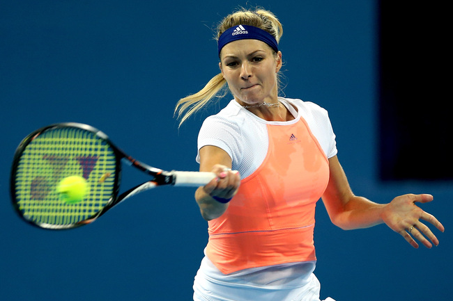 Hi-res-182275832-maria-kirilenko-of-russia-returns-a-shot-to-jie-zheng_crop_650