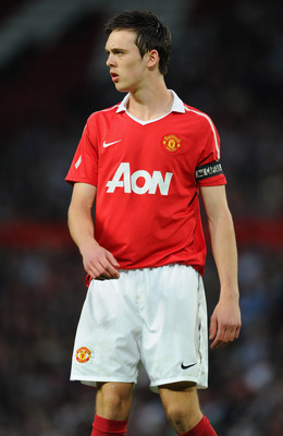 Hi-res-112748790-tom-thorpe-of-manchester-united-looks-on-during-the-fa_display_image