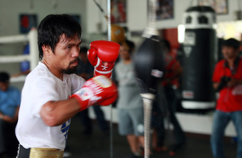 Hi-res-183691914-manny-pacquiao-takes-part-in-a-training-session-on_display_image