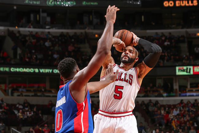 Hi-res-184804192-carlos-boozer-of-the-chicago-bulls-shoots-against-andre_crop_650