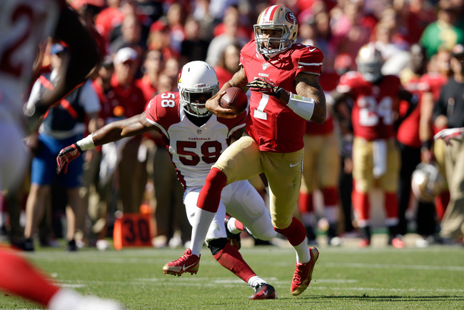 Hi-res-184419401-colin-kaepernick-of-the-san-francisco-49ers-runs-past_crop_650