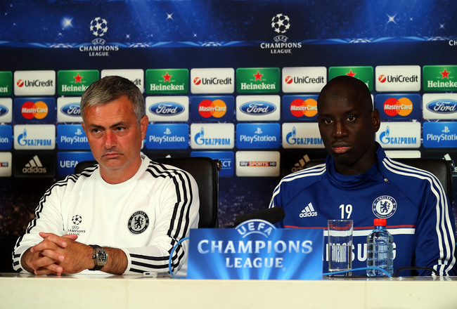 Hi-res-180873222-jose-mourinho-and-demba-ba-of-chelsea-speak-during-a_crop_650x440