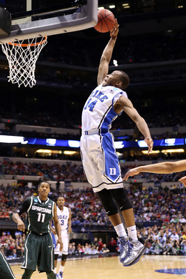 Hi-res-164969575-rasheed-sulaimon-of-the-duke-blue-devils-dunks-in-the_display_image