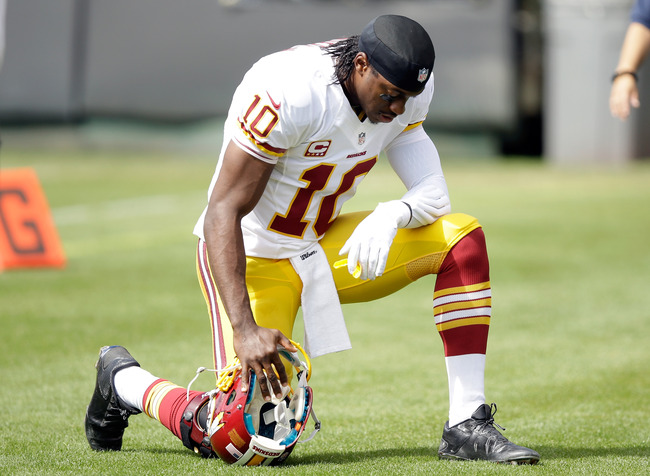 Hi-res-182619474-robert-griffin-iii-of-the-washington-redskins-prays-on_crop_650