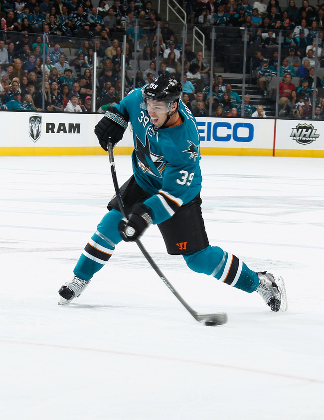 Hi-res-183704254-logan-couture-of-the-san-jose-sharks-shoots-the-puck_crop_650