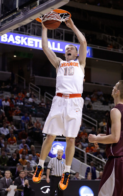 Hi-res-164259641-trevor-cooney-of-the-syracuse-orange-goes-up-for-a-dunk_display_image