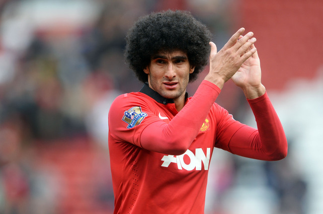 Hi-res-180524047-marouane-fellaini-of-manchester-united-applauds-the_crop_650