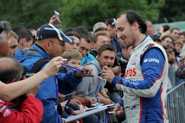 Hi-res-177593118-robert-kubica-of-poland-attends-with-a-lot-of-fans-in_crop_650