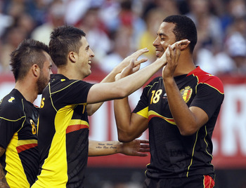 Hi-res-169639255-kevin-mirallas-of-belguim-celebrates-moussa-dembele_display_image