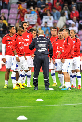 Hi-res-180300458-the-chilean-team-warm-up-prior-to-the-spain-v-chile_display_image