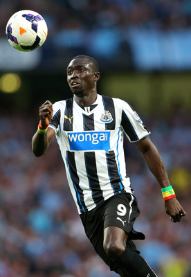 Hi-res-176935768-papiss-demba-cisse-of-newcastle-united-chases-the-ball_display_image