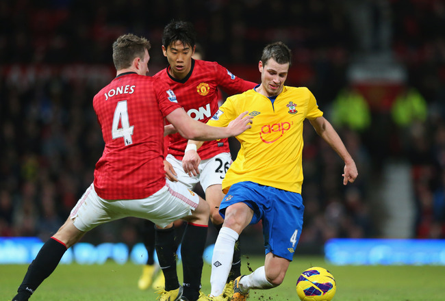 Hi-res-160388249-morgan-schneiderlin-of-southampton-holds-off-shinji_crop_650x440