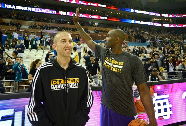 Hi-res-185037147-kobe-bryant-of-the-los-angeles-lakers-greets-the-fans_crop_650x440