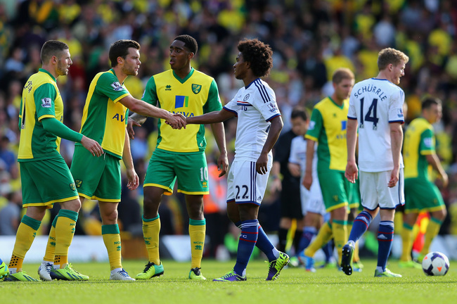 Hi-res-183436227-willian-of-chelsea-shakes-hands-with-the-norwich_crop_650