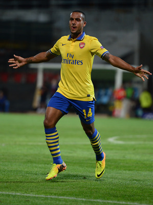 Hi-res-180963792-theo-walcott-of-arsenal-celebrates-his-goal-during-the_display_image