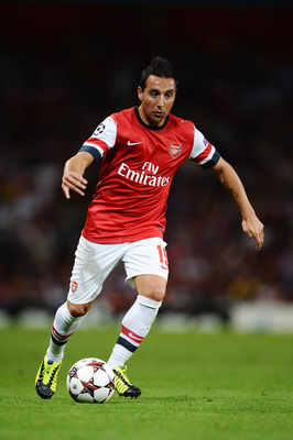 Hi-res-178218675-santi-cazorla-of-arsenal-runs-with-the-ball-during-the_display_image