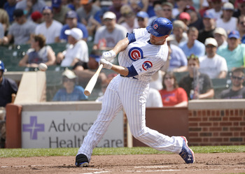 Hi-res-178678914-nate-schierholtz-of-the-chicago-cubs-follows-through-on_display_image