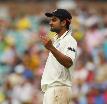 Hi-res-136388465-virat-kohli-of-india-gestures-with-his-middle-finger-to_display_image