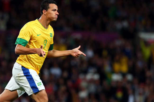 Hi-res-149948619-leandro-damiao-of-brazil-reacts-after-scoring-during_crop_650