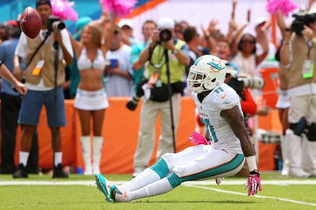 Hi-res-183447423-mike-wallace-of-the-miami-dolphins-reacts-to-making-a_crop_650