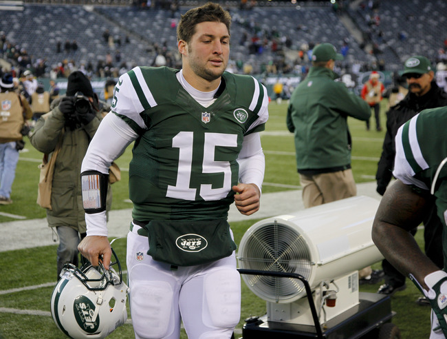 Hi-res-158683838-tim-tebow-of-the-new-york-jets-leaves-the-field-after_crop_650