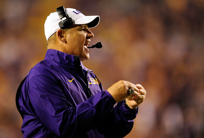 Hi-res-180590799-les-miles-head-coach-of-the-lsu-tigers-instructs-his_crop_650x440
