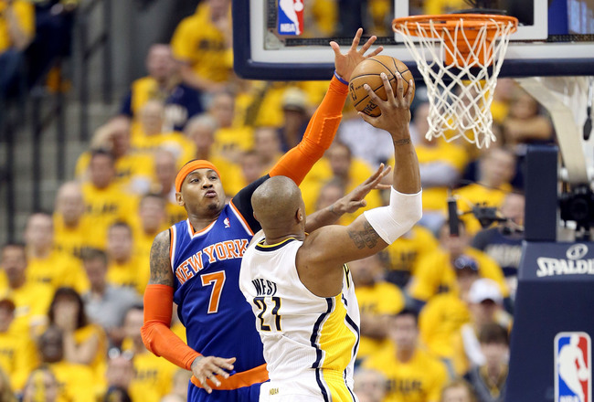 Hi-res-169025359-carmelo-anthony-of-the-new-york-knicks-defends-the-shot_crop_650x440
