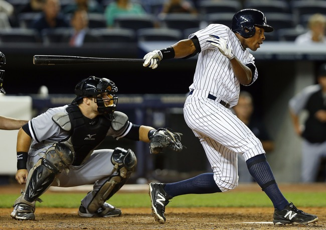 Hi-res-179452851-curtis-granderson-of-the-new-york-yankees-singles-in_crop_650