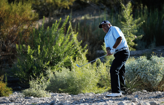 Hi-res-185145617-angel-cabrera-of-argentina-plays-a-shot-from-the-rocks_crop_650
