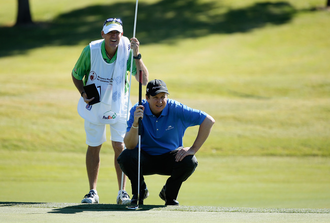 Hi-res-185143298-henry-lines-up-his-eagle-putt-with-his-caddie-don_crop_650