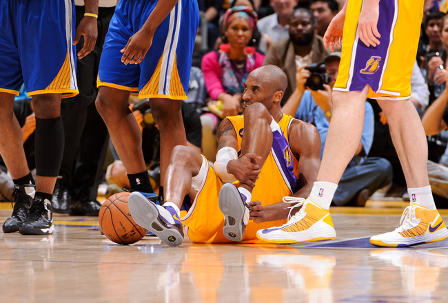 Hi-res-166466973-kobe-bryant-of-the-los-angeles-lakers-reacts-on-the_crop_650x440