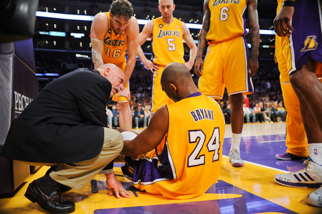 Hi-res-166467620-kobe-bryant-of-the-los-angeles-lakers-speaks-with-head_crop_650