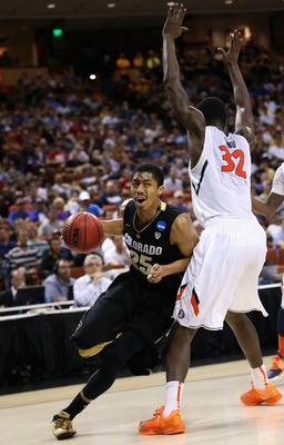 Hi-res-164328851-spencer-dinwiddie-of-the-colorado-buffaloes-dribbles_display_image