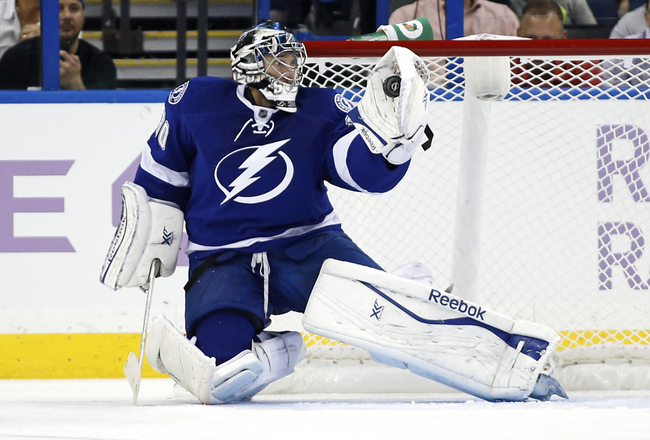 Hi-res-185153377-ben-bishop-of-the-tampa-bay-lightning-makes-a-save_crop_650x440