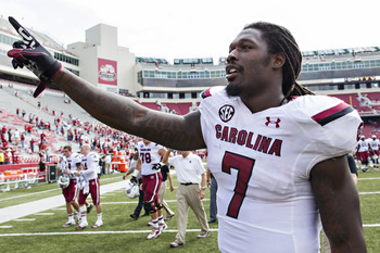 Hi-res-184228159-jadeveon-clowney-of-the-south-carolina-gamecocks-raises_display_image