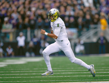 Hi-res-184791378-quarterback-marcus-mariota-of-the-oregon-ducks-rushes_display_image