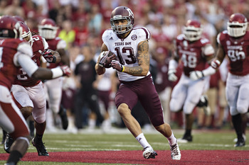 Hi-res-182264053-mike-evans-of-the-texas-a-m-aggies-runs-the-ball_display_image