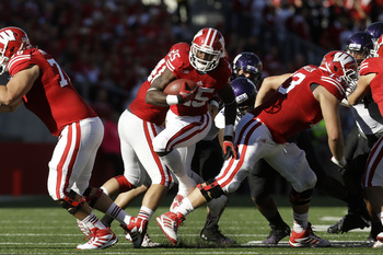 Hi-res-184237463-melvin-gordon-of-the-wisconsin-badgers-runs-upfield_display_image