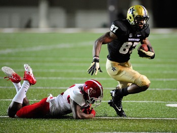 Hi-res-180002679-jordan-matthews-of-the-vanderbilt-commodores-breaks-a_display_image