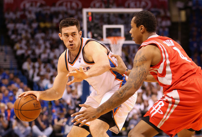 Hi-res-167857104-nick-collison-of-the-oklahoma-city-thunder-handles-the_crop_650