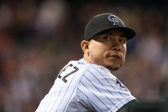Hi-res-181493216-carlos-gonzalez-of-the-colorado-rockies-looks-on-from_crop_650
